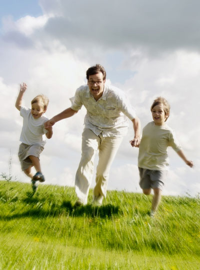 Dad running with kids
